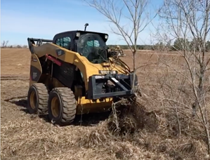 Virnig Tree Puller attachment and skid loader removing a tree